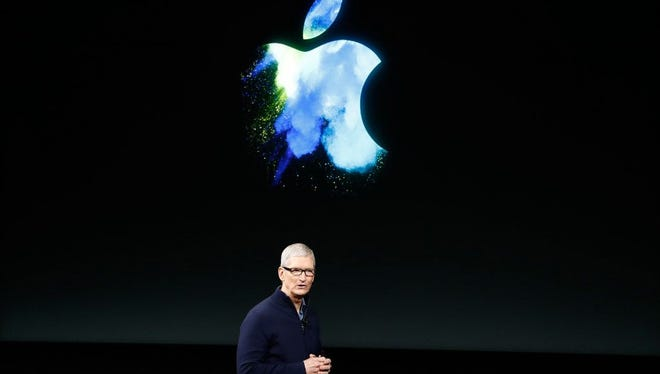 Apple CEO Tim Cook speaks on stage during an Apple product launch in October.