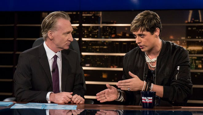 """In this photo provided by HBO, host Bill Maher, left, listens to Milo Yiannopoulos, a writer for Breitbart News, on HBO's """"Real Time with Bill Maher,"""" Friday, Feb. 17, 2017, in Los Angeles."""