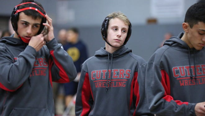 Fair Lawn 106 pound wrestler, freshman Dylan Cedeno (center), exudes confidence which he displayed at the Cutters Classic Tournament at which he pinned 3 opponents including his final opponent of the day, River Dell's Jared Wagreich.