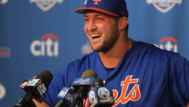 Tim Tebow laughs during his press conference Monday.