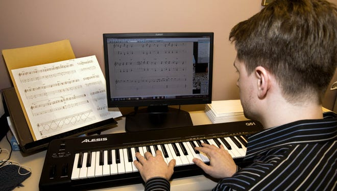 Elliot Unkefer, music engraver for Hal Leonard Corporation, takes sheet music and digitizes the content for various platforms.