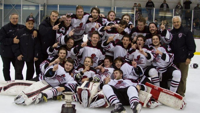 The Ramapo College ice hockey team celebrates after defeating Suffolk, 4-3 on Feb. 19 to win the MCHC championship.