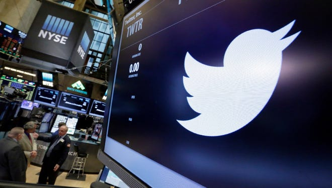 The symbol for Twitter appears above its trading post on the floor of the New York Stock Exchange.