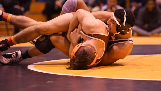 Rutherford senior Omar Abdelhamid, right, is 39-0 heading into the 152-pound state finals bracket in Atlantic City.