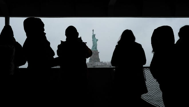 Onlookers view the Statue of Liberty.