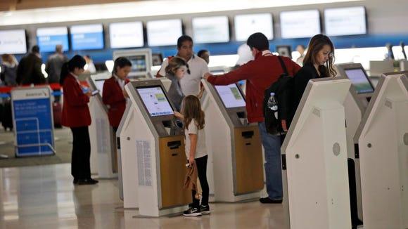 Travelers check in at kiosks at San Francisco International