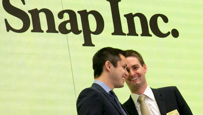 Snapchat co-founders Bobby Murphy, left, and CEO Evan Spiegel ring the opening bell at the New York Stock Exchange as the company celebrates its IPO, Thursday, March 2, 2017