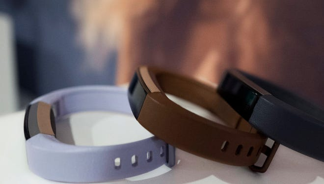 In this March 1, 2017 photo in New York, Fitbit's new Alta HR is shown in several colors. The new sleep tools come as Fitbit announces an updated version of its Alta tracker. The new version has heart rate monitoring and seven days of battery life. It goes on sale in April for about $150.