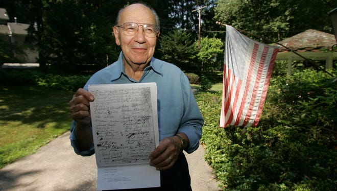 Closter historian Arthur Goldberg holds a copy of the 1795 deed signed by all the landholders in the area at the time, declaring that Blanch Avenue be developed into a road.