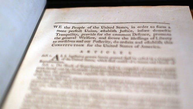 NEW YORK, NY - JUNE 15:  A copy of former President George Washington's personal copy of the Constitution and Bill of Rights is displayed at Christie's auction house on June 15, 2012 in New York City. The artifact, which is signed and has notes by Washington, will be put up for auction on June 22 and is expected to sell for $2 million to $3 million.  (Photo by Spencer Platt/Getty Images)