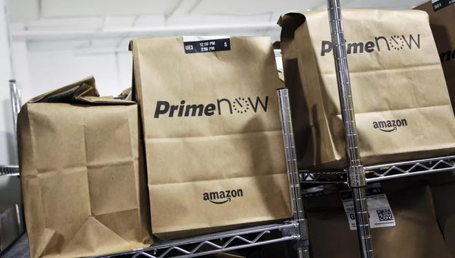 Bags are loaded for delivery at Amazon's urban fulfillment facility, Tuesday, Dec. 22, 2015 in New York. Amazon Prime Now is one of the perks of Amazon Prime membership.