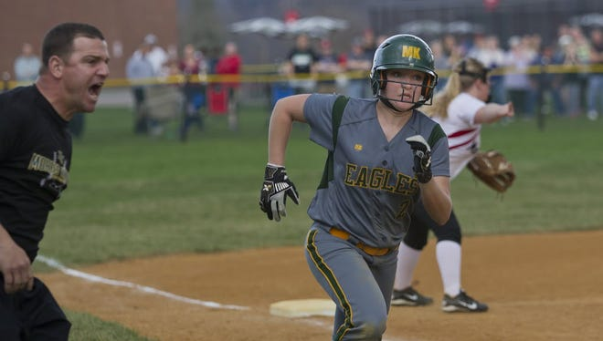 Morris Knolls' Jessica Heitmann rounding third and headed for home during a game last season.