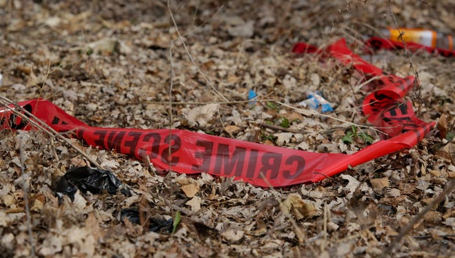 In this Feb. 15, 2017 photo, police tape litters the ground at the scene of a Feb. 14, shooting that killed a toddler and a man authorities say was the intended target in Chicago, Ill. City and federal law enforcement authorities on Friday announced more than three dozens arrests targeting open-air drug dealing on Chicago's West Side. Police Supt. Eddie Johnson argues that drug dealing is fueling Chicago's interminable gun violence.