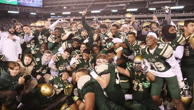 The Green Knights celebrate their 2016 Non-Public Group 3 state title at MetLife Stadium.