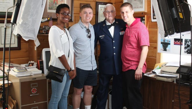 Interviewing Al in his home are A/1C Desiree Ware, S/A Codie Trimble and S/A Nicholas Brown.