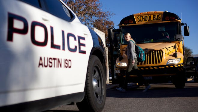 An Austin Independent School District police vehicle sits outside of McCallum High School in Austin Texas. AISD has its own police force with armed officers at middle and high schools. Following the Sandy Hook Elementary School shooting, these officers were on higher alert and the Austin Police Department dispatched officers to all elementary schools. The Texas Tribune (Smith: School Security). Credit: Tamir Kalifa for The Texas Tribune. police officer McCallum high school is a permanent  . Following the Sandy Hook Elementary School shooting, the armed officers at all middle and high schools were placed on higher alert and the Austin Police Department dispatched officers to all elementary schools. As the 83rd Legislature approaches, Texas lawmakers are considering making firearms more available to teachers and other school personnel. The Texas Tribune (Smith: School Security). Credit: Tamir Kalifa for The Texas Tribune.