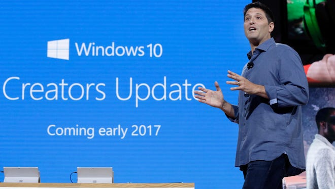 """In this Wednesday, Oct. 26, 2016, file photo, Terry Myerson, Microsoft's executive vice president of the Windows and Devices Group, discusses a Windows 10 update at a Microsoft media event in New York. The major update to Microsoft's Windows 10 system will start reaching consumers and businesses on April 11, 2017. New features in the """"Creators Update"""" include 3-D drawing tools, game-broadcasting capabilities and the ability to annotate maps and photos. Microsoft also is changing its update procedures to make them less disruptive."""