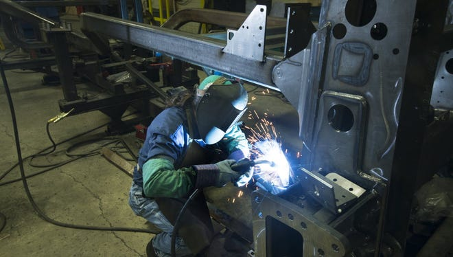 A worker welds metal parts at Super Steel in Milwaukee in this photo from 2015. Super Steel is part of the Accelity Group.