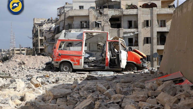 Destroyed ambulance outside the Syrian Civil Defense main center after airstrikes in Aleppo, Syria.
