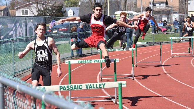 Athletes competing in 400-meter intermediate hurdles at Passaic County Relays.