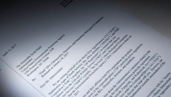 """This letter obtained by the Associated Press and photographed in the news agency's Washington bureau, Wednesday, April 19, 2017, was sent to EPA Administrator Scott Pruitt by attorneys representing Dow Chemical requesting the EPA """"to set aside"""" the results of government studies they claimed were fundamentally flawed. Dow Chemical CEO Andrew Liveris is a close adviser to President Donald Trump. The company gave $1 million for Trump's inaugural activities."""