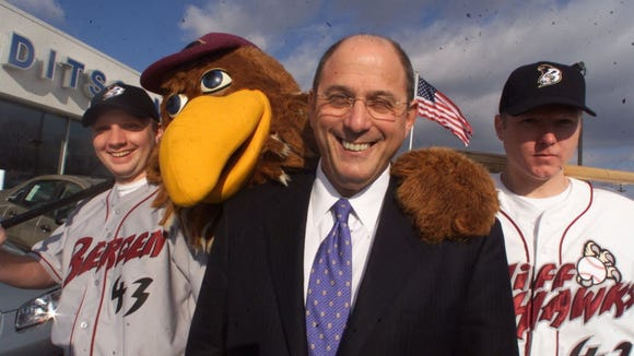 Bergen Cliff Hawks mascot Homer and two players dressed in team uniforms were joined by would-be team owner Steve Kalafer in this Dec. 2002 photo.