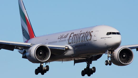 An Emirates airline Boeing 777-200LR flies near Everett,