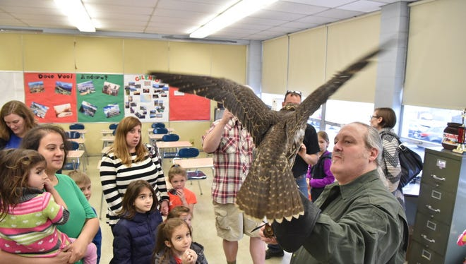 Bill Ponder and his falcon at Hawthorne's Earth Day celebration on Saturday.