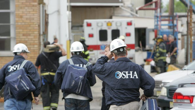 In this May 2012 file photo, an OSHA team arrives at the site of an industrial accident. You can learn how to reduce risking using OSHA consultation at a free clinic on Aug. 7 at the Bell Tower Plaza in Hagåtña.