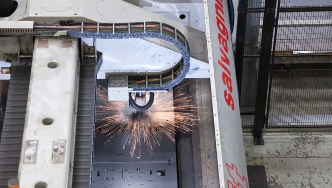 Allenton's Maysteel Industries has been sold to the private equity firm Littlejohn Capital. Pictured here is a laser in use at the Allenton facility.