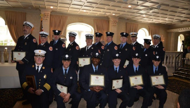 Firefighters involved in the trench rescue display their awards at a ceremony at Nanina's in the Park in Belleville.
