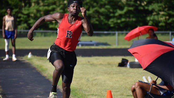 A Rossview athlete competes in the triple jump during the Class AAA Sectional track and field meet Monday at West Creek High.