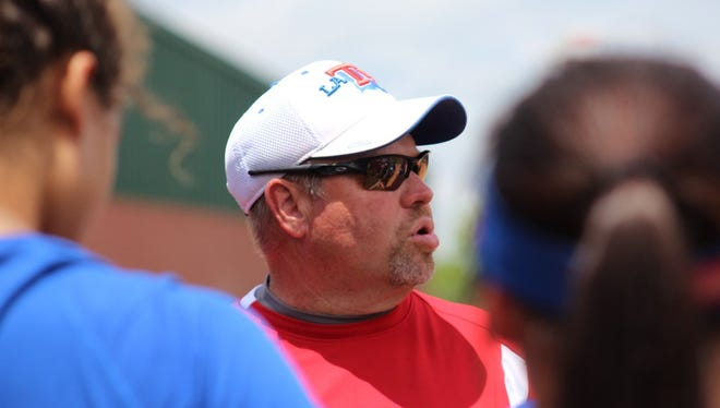 Louisiana Tech coach Mark Montgomery talks to his players during Thursday's practice in Alabama.