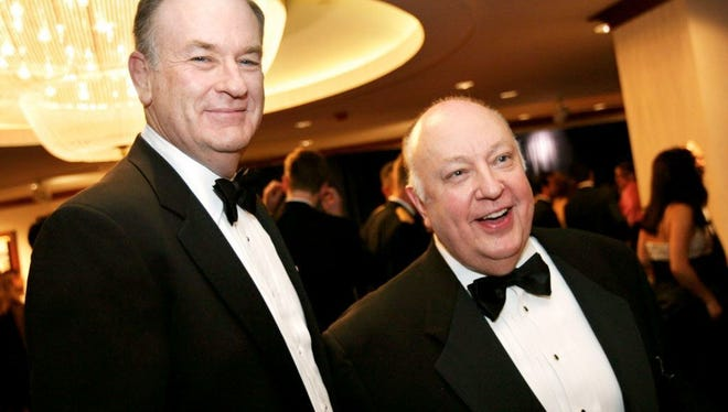 Bill O?Reilly and Roger Ailes attend the Radio & TV Correspondents dinner in 2003.