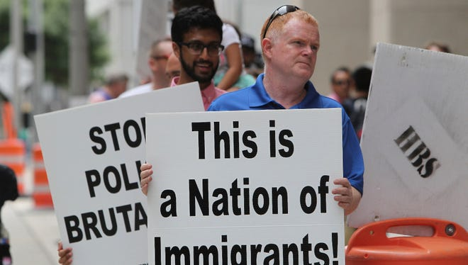 Protesters outside Houston Police Department headquarters on Saturday, objecting to the enforcement of a law that lets officers inquire about a person's immigration status.