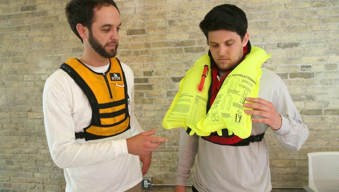 Mike Fox (left) and Pat Hughes of Hyde Sportswear developed the Wingman, a thin and more comfortable inflatable life jacket.
