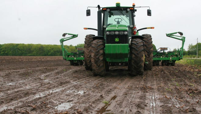 Spring planting is way behind schedule in some places in Wisconsin because wet weather has left the fields a muddy mess.