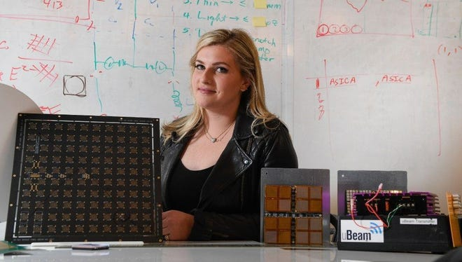 Meredith Perry, 27, is surrounded by various prototypes of her company's ultrasound wireless charging tech. uBeam demonstrated a working model for USA TODAY.
