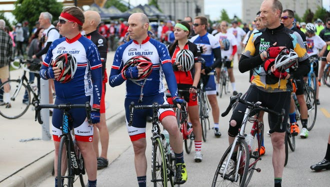 Riders at the 2016 UPAF Ride for the Arts listen to the National Anthem at the start of the event. at Summerfest's South Gate. This year's ride is Sunday, starting at 7 a.m. at Summerfest.