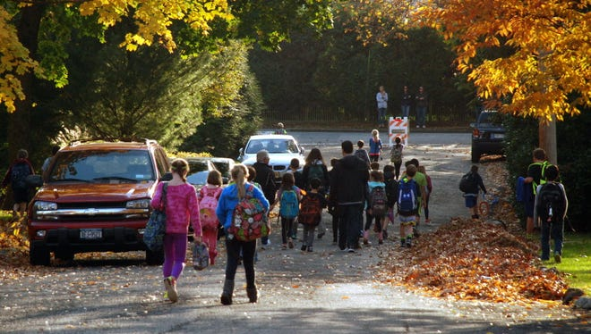 Children walk home from Ridge Elementary School on Clinton Avenue, which will soon be open during the day due to a move to full-day kindergarten.