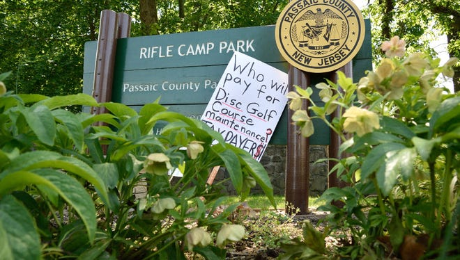A protest sign at the entrance to Rifle Camp Park in Woodland Park.