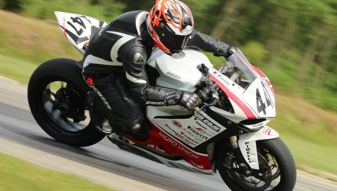 Michael Casey, co-founder of Motovid, a Delavan firm that offers motorcycle riding classes on a paved track, rides his Ducati Panigale 1199 at Blackhawk Farms Raceway. --- Photo by Peter Lilly, Zone Photo