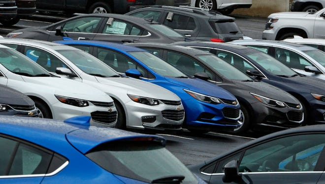 In this Thursday, Jan. 12, 2017, photo, Chevrolet cars sit on the lot of a dealer in Pittsburgh. General Motors and Ford both reported U.S. auto sales declines for June on Monday.