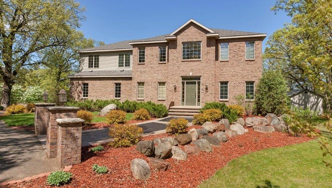 A three story home stands on the banks of the Mississippi River  at 42062 Stearns County Road 1 in Rice.