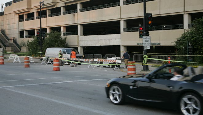 The O'Donnell Park parking garage, shortly after a 13-ton concrete panel fell in the exit lanes, killing a 15-year-old boy in 2010.