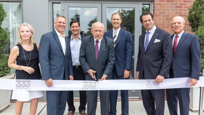 Mayor Andy Skibitsky and executives from real estate and development companies meet in Westfield for the ribbon-cutting of the new apartments at 333 Central Ave.