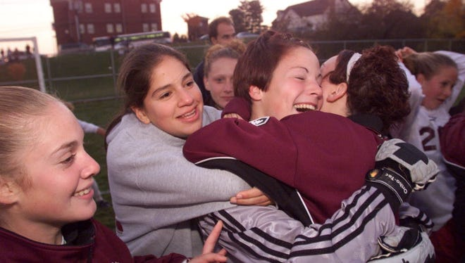 Andrea Kovalcik (center), here after winning North 1, Group 4 title, was one of several key players on Clifton's 2001 team.
