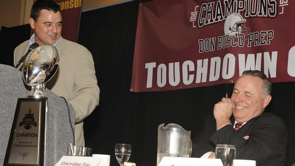 From 2010: Nunzio Campanile, left, shares a laugh with former Don Bosco football coach Greg Toal at a dinner to honor Toal  after the Ironmen's national title in the 2009 season.