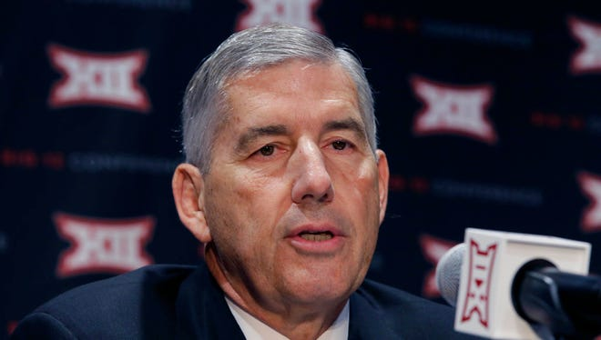FILE - In this Oct. 17, 2016, file photo, Big 12 Commissioner Bob Bowlsby speaks to reporters after The Big 12 Conference meeting in Grapevine, Texas. When the Big 12 kicks off its football media days on Monday, July 17, 2017, commissioner Bob Bowlsby will be able to tout a winning record in bowl games last season and the still-growing revenue for the league's 10 schools. What the league really needs this season is to get a team into the College Football Playoff.(AP Photo/LM Otero, File)