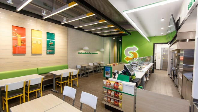 This January 2017 photo provided by Subway shows the interior of a remodeled Subway store in Knoxville, Tenn. Subway is looking to update the look of its stores as the chain's U.S. sales have been declining. The company says the redesign, which includes a brighter atmosphere, displays of vegetables behind the counter and ordering tablets, is the first major revamp since the early 2000s.